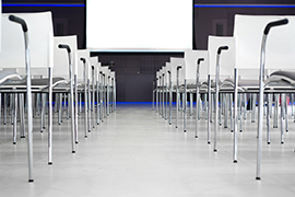 Chairs lined up in front of a projection screen